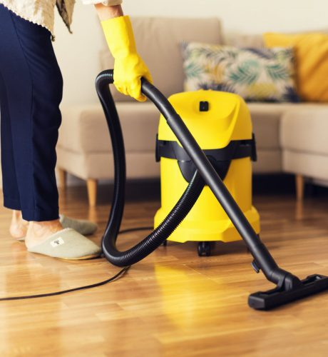 woman-cleaning-sofa-with-yellow-vacuum-cleaner-cop-MJAU3X2.jpg